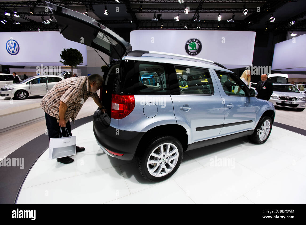 A visitor looks at a Skoda an automobile show of the Volkswagen AG in Hamburg, Germany. - Stock Image