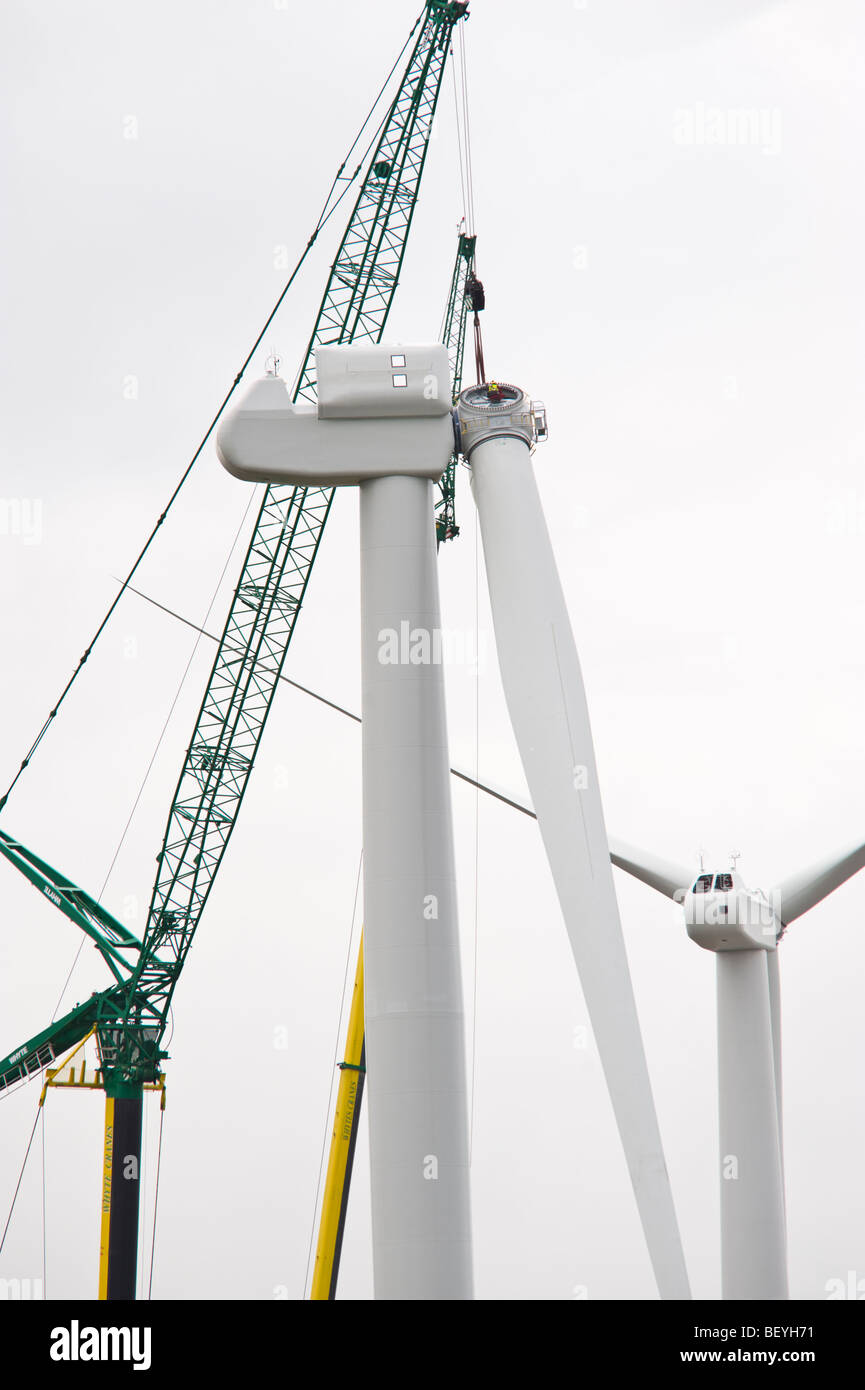 Blades being lifted by cranes for fitting on Nordex N90 wind turbine under construction at Solutia UK Ltd Newport - Stock Image