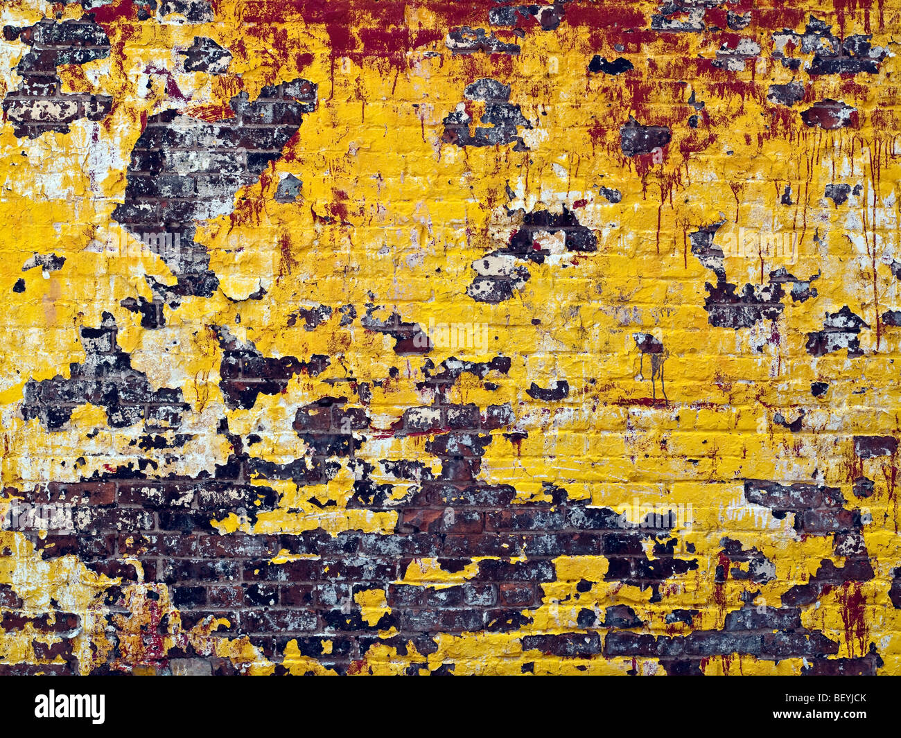 A old building wall with fading and chipping paint in New York City ...