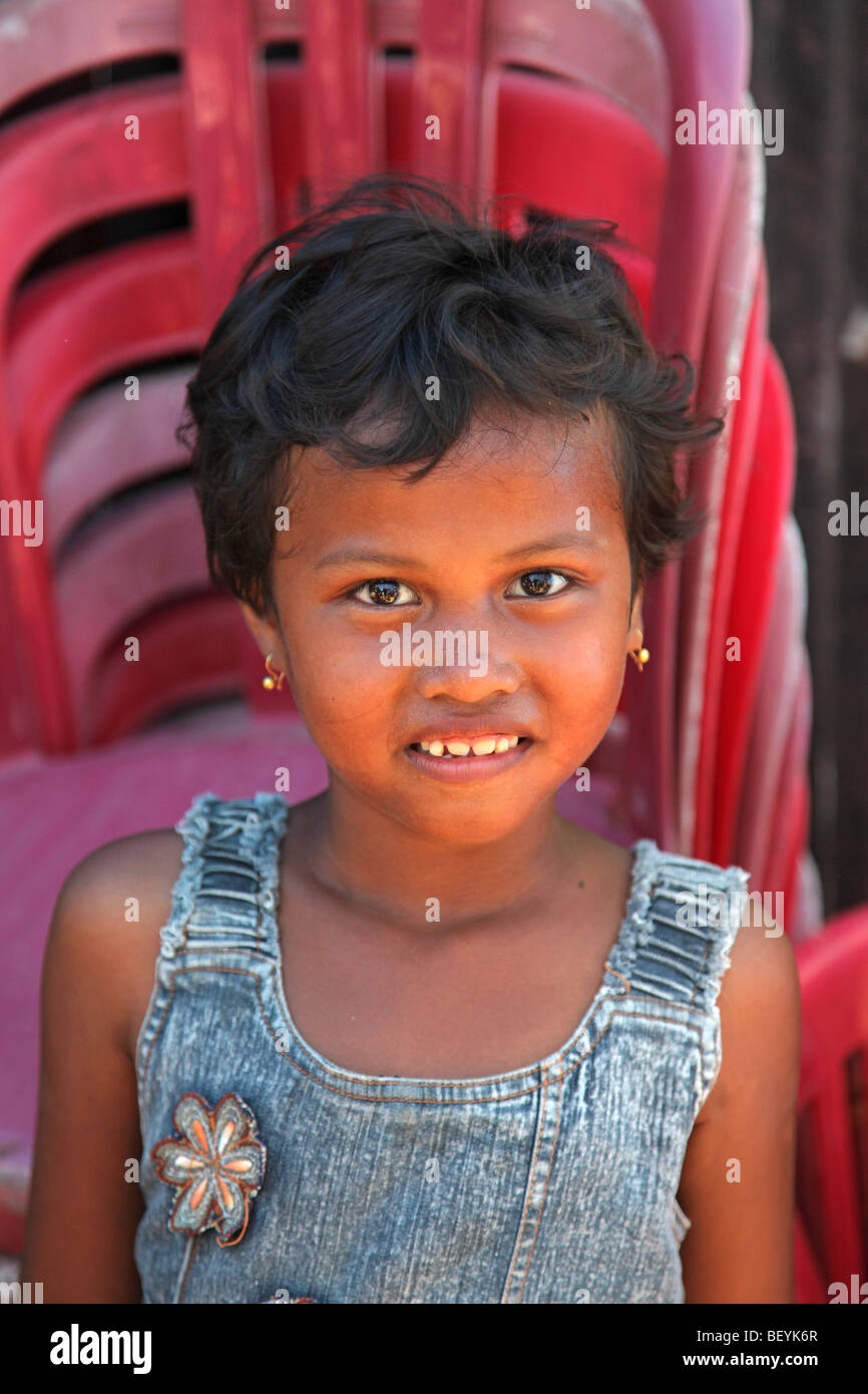 Girl with red chair, Jawi Duku, West Sumatra, Indonesia - Stock Image