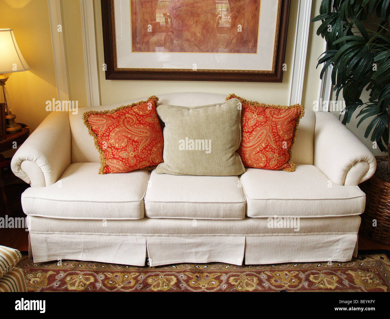 A comfortable sofa in a well decorated room - Stock Image