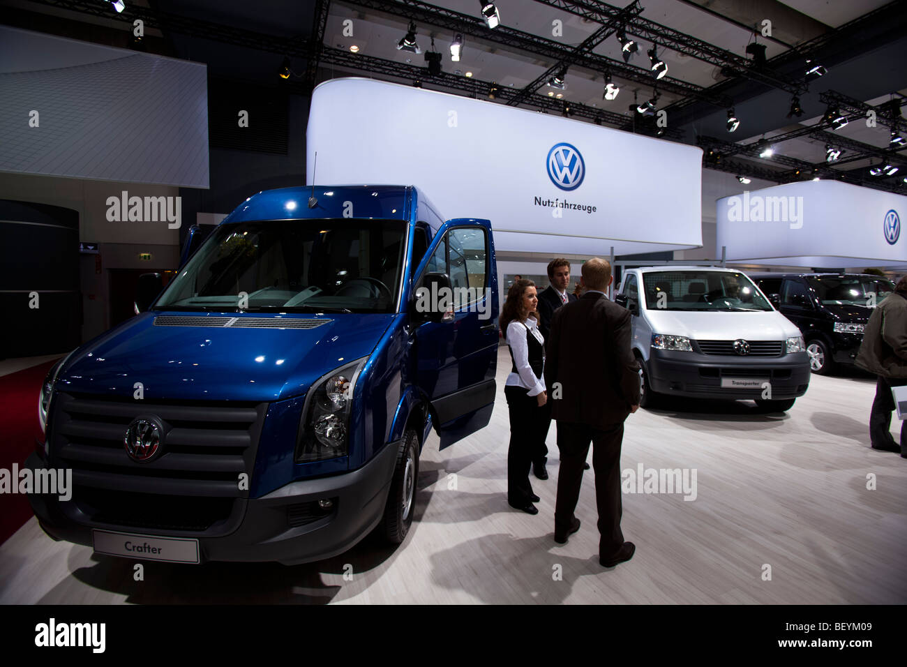 VW commercial vehicles are seen at an automobile show of the Volkswagen AG in Hamburg, Germany. - Stock Image
