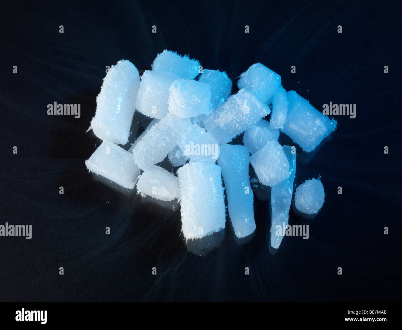 Dry Ice nuggets sublimating in room temperature - Stock Image