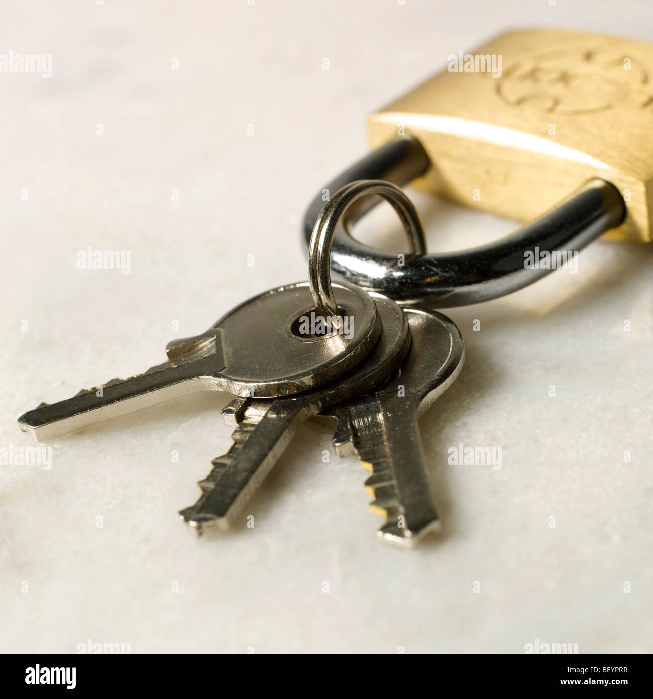 Padlock with three keys. - Stock Image