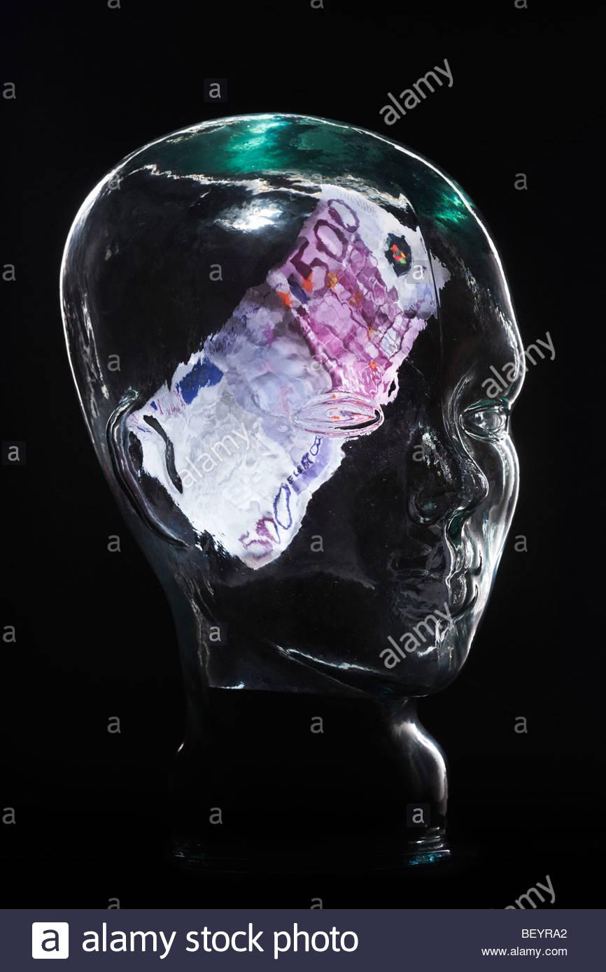 500 euro bill in glass head - Stock Image