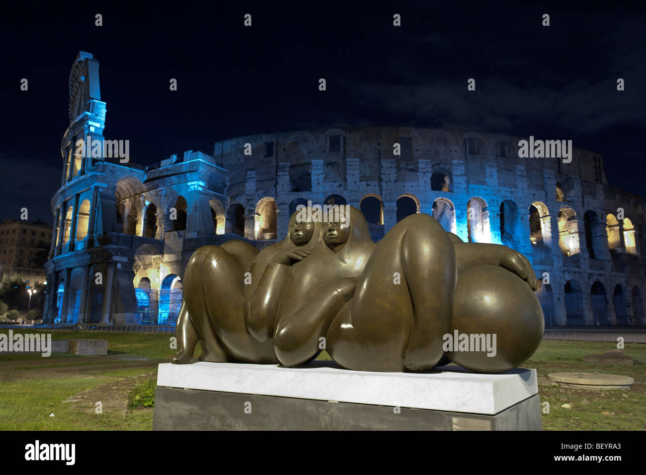 Rome, Italy. A modern bronze sculpture in Piazza del Colosseo, by night. Stock Photo