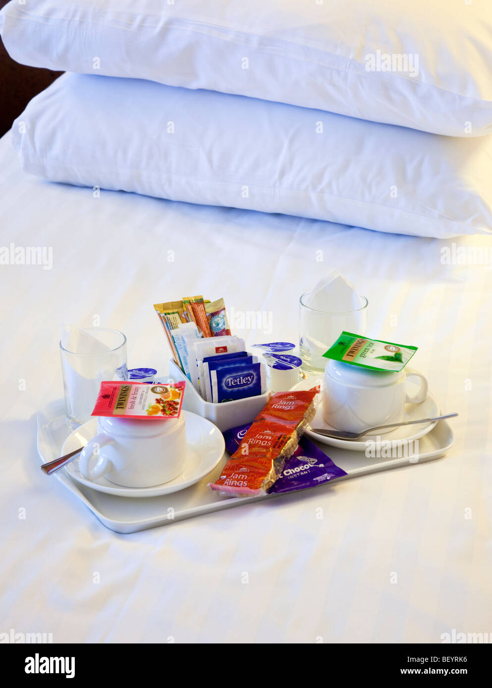 Tea and coffee tray on a hotel room bed - Stock Image