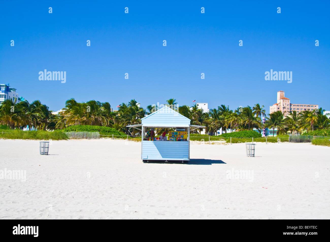 Beach hut shop miami beach south beach miami florida usa. Ocean drive in the background, palm trees blue sky - Stock Image