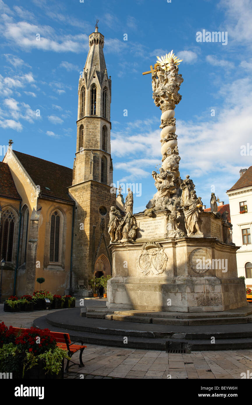 The Holy Trinity Statue and the Goat's Church (Kecske templom )- Fo Square (Fő Ter) - Sopron, Hungary - Stock Image