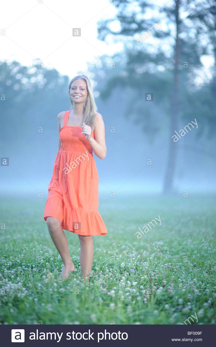 Young Woman on Meadow - Stock Image