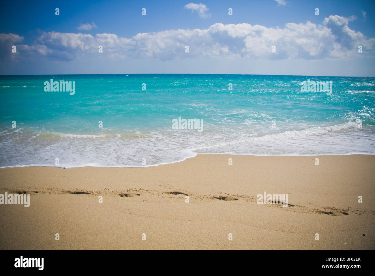 Footprints in sand and stunning blue ocean at Miami beach. South beach Miami Florida USA - Stock Image