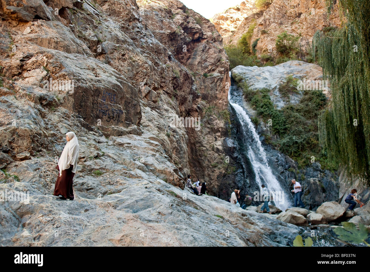 Tourists visiting waterfall in Setti Fatma berber village in Ourika valley, high Atlas mountains , Morocco. - Stock Image