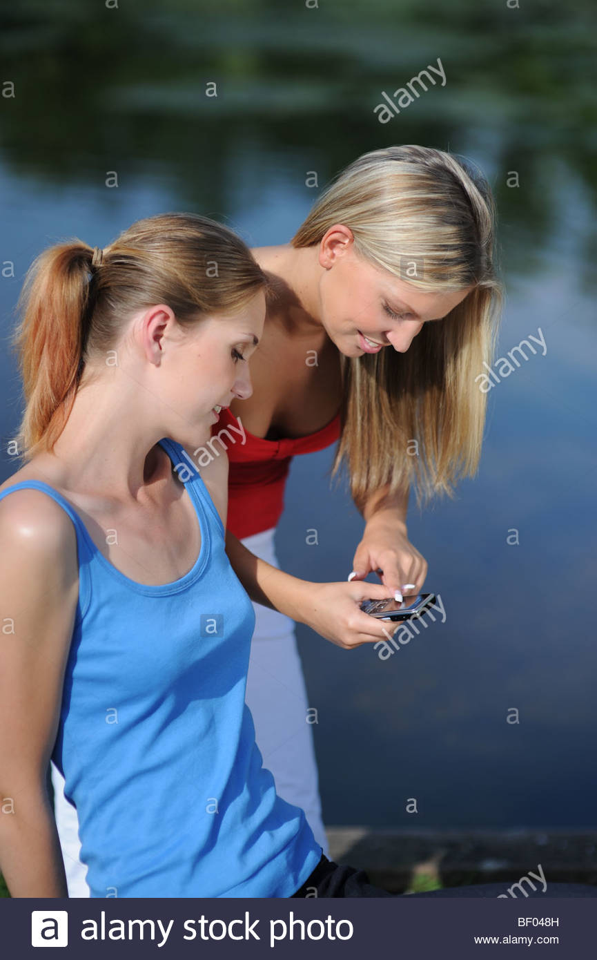 Young Women on Pier - Stock Image