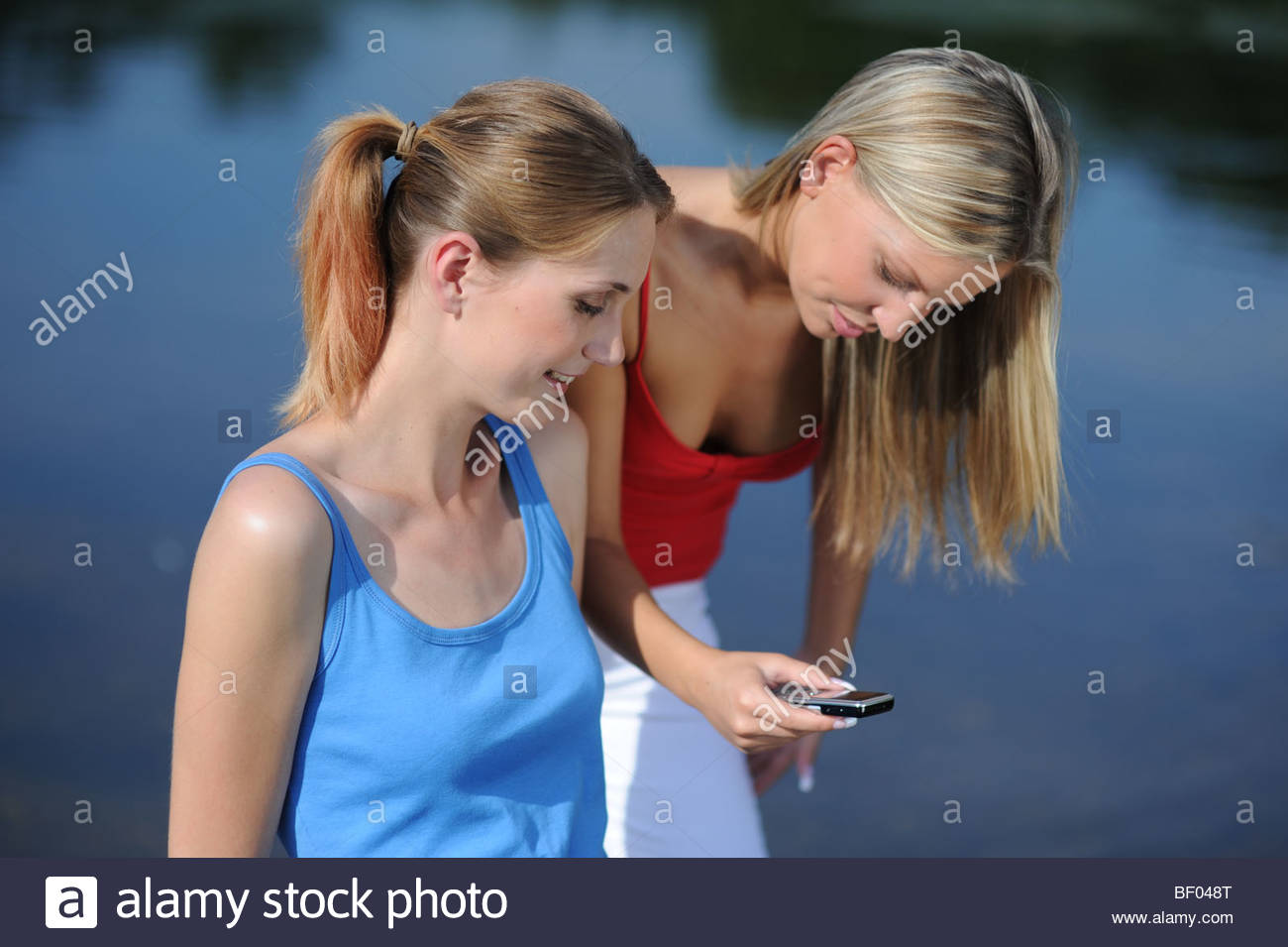 Young Women with Mobile Phone Stock Photo