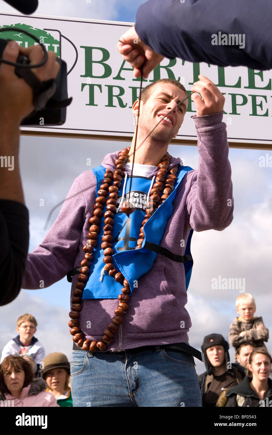 Disappointed BBC Blue Peter TV presenter Joel Defries looses his nut while competing at the 45th World Conker Championships Stock Photo