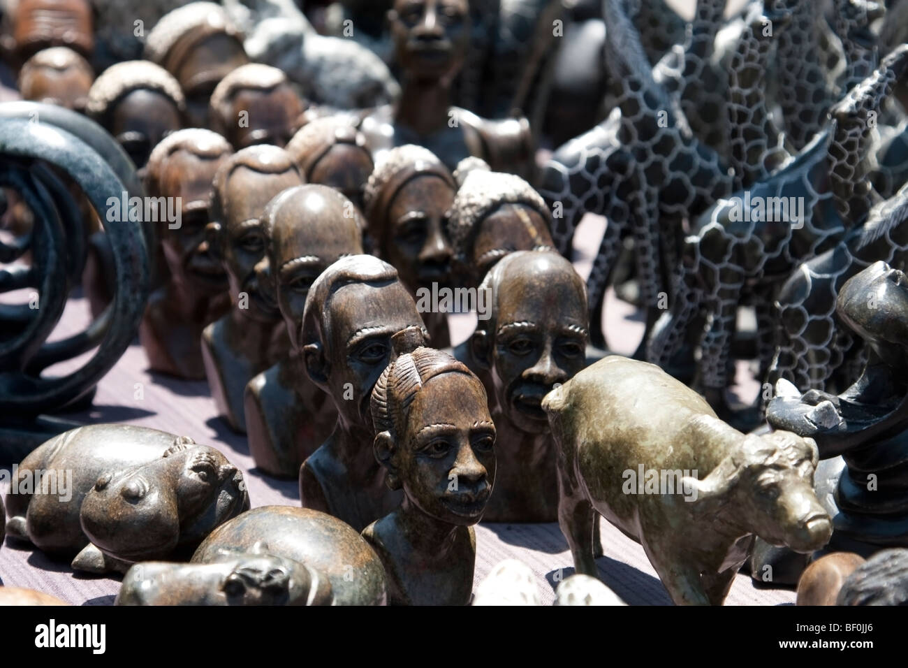 Stone and wooden curios for sale in South Africa - Stock Image