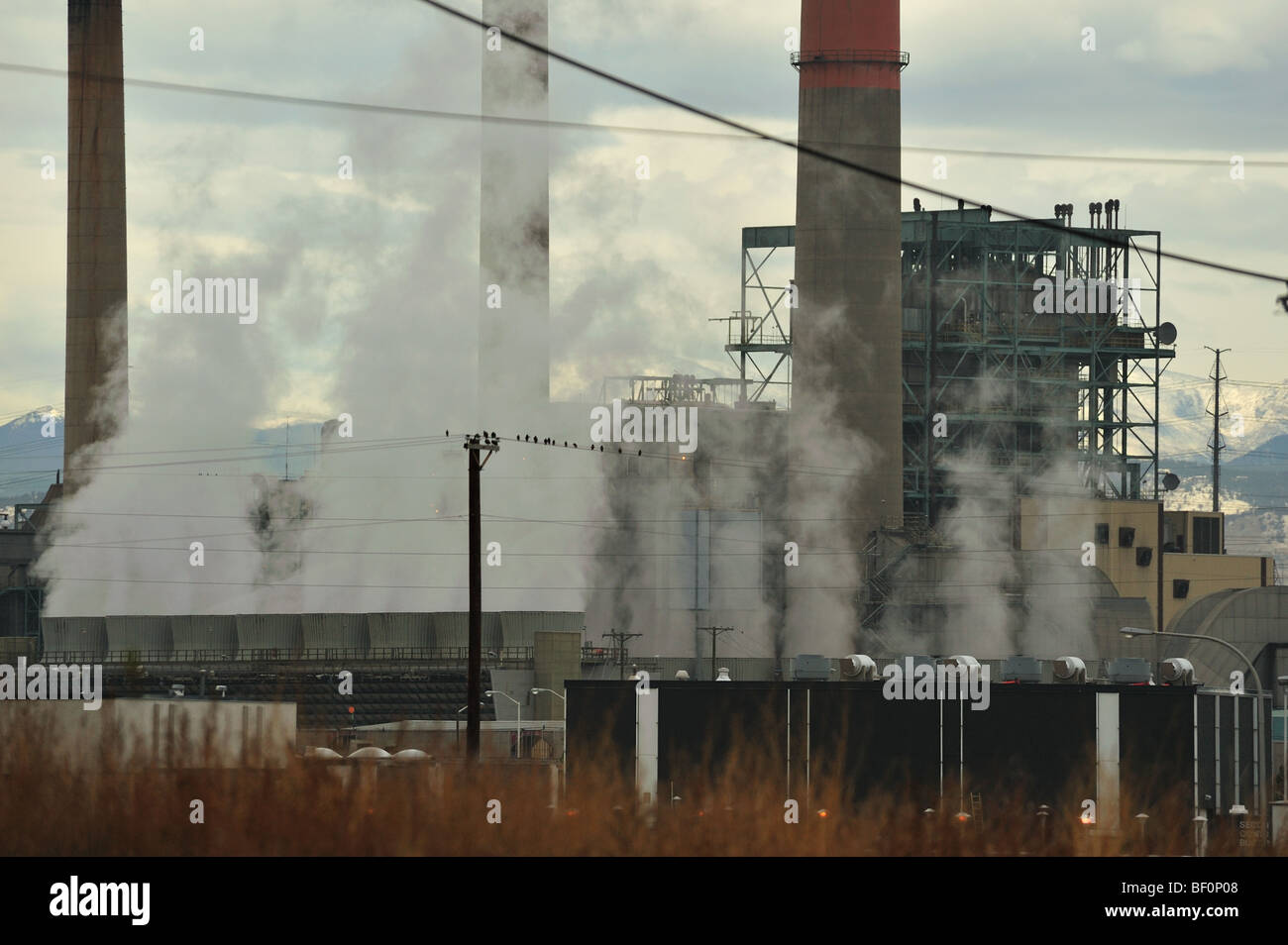 Coal-fired power plant with smoke stacks - Stock Image