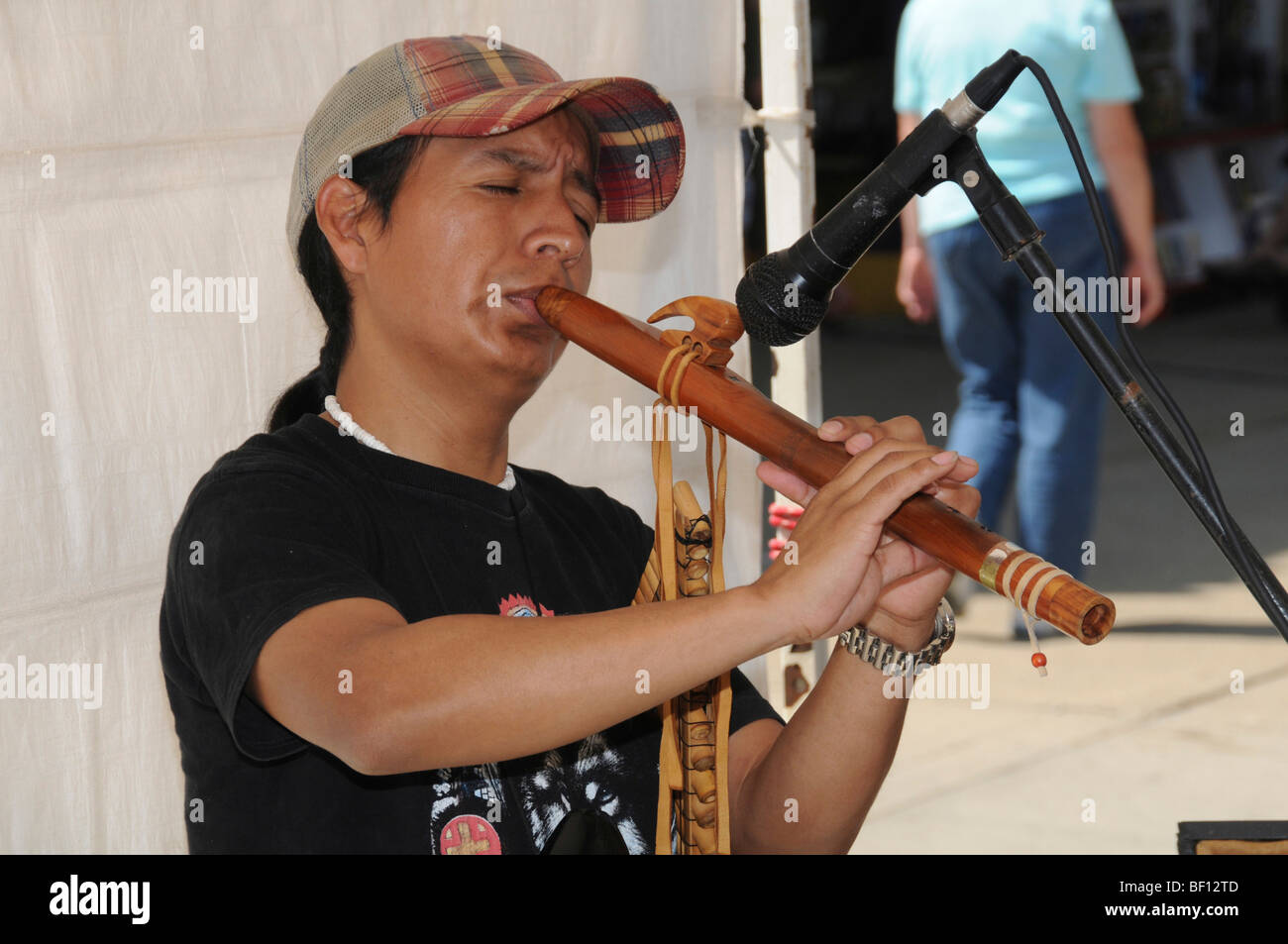 man playing a flute - Stock Image