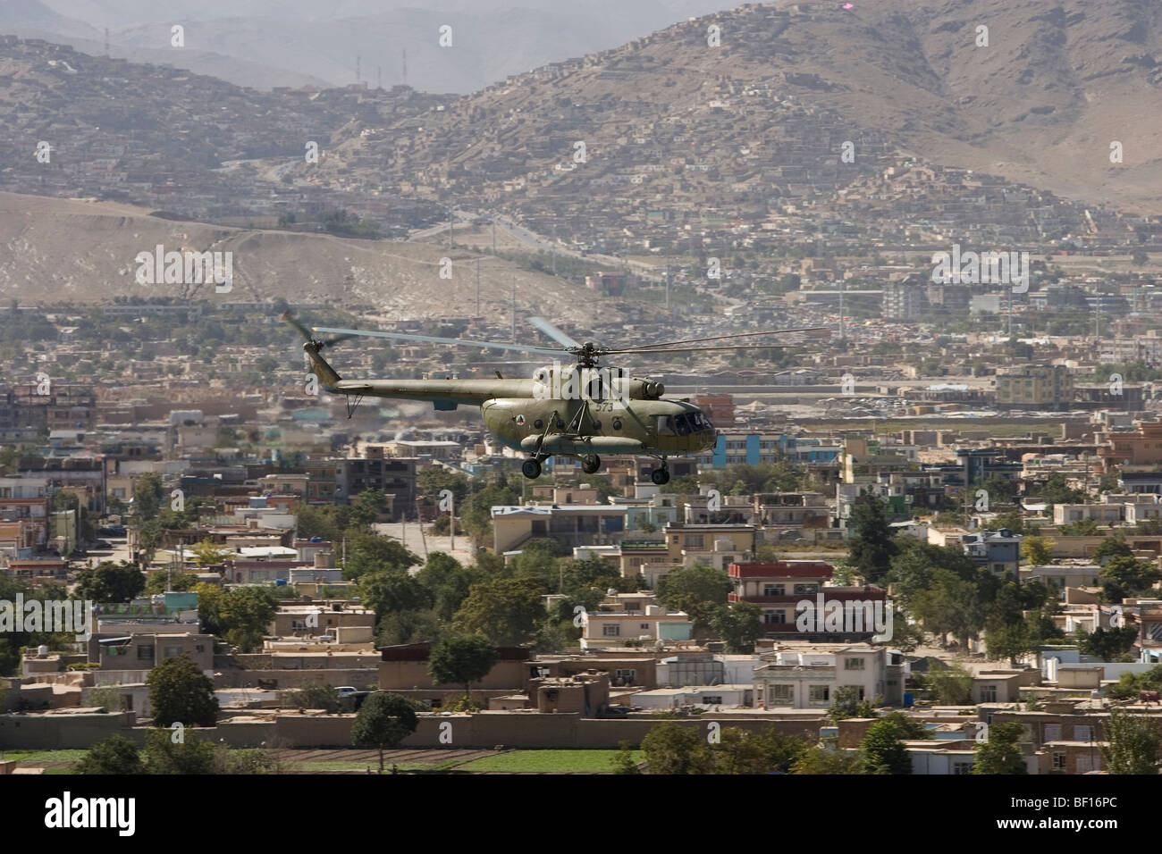 NATO ISAF helicopter flies over the city of Kabul Afghanistan on routine mission - Stock Image