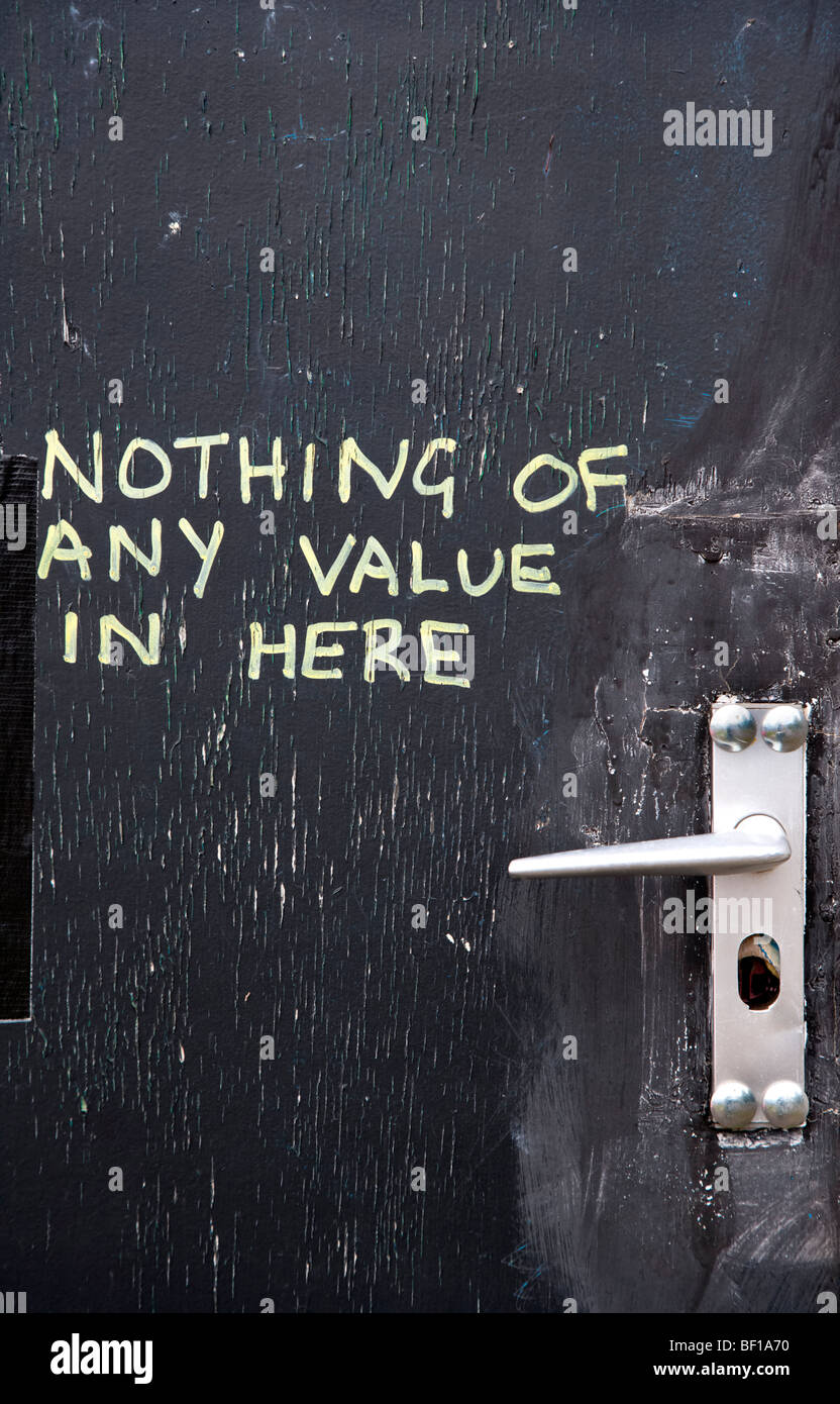 Door with Nothing Of Any Value written on the outside to deter burglars - Stock Image