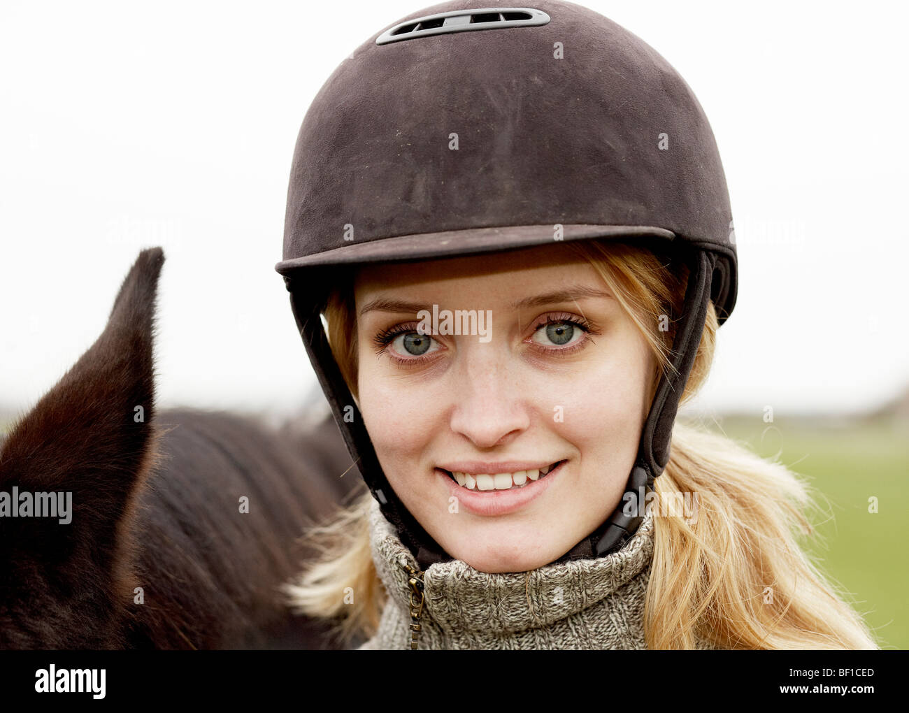 Portrait of a woman wearing a riding helmet, Sweden. - Stock Image