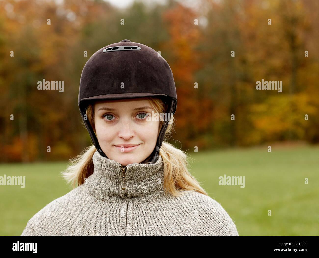 Portrait of a woman wearing a riding helmet, Sweden. - Stock Image