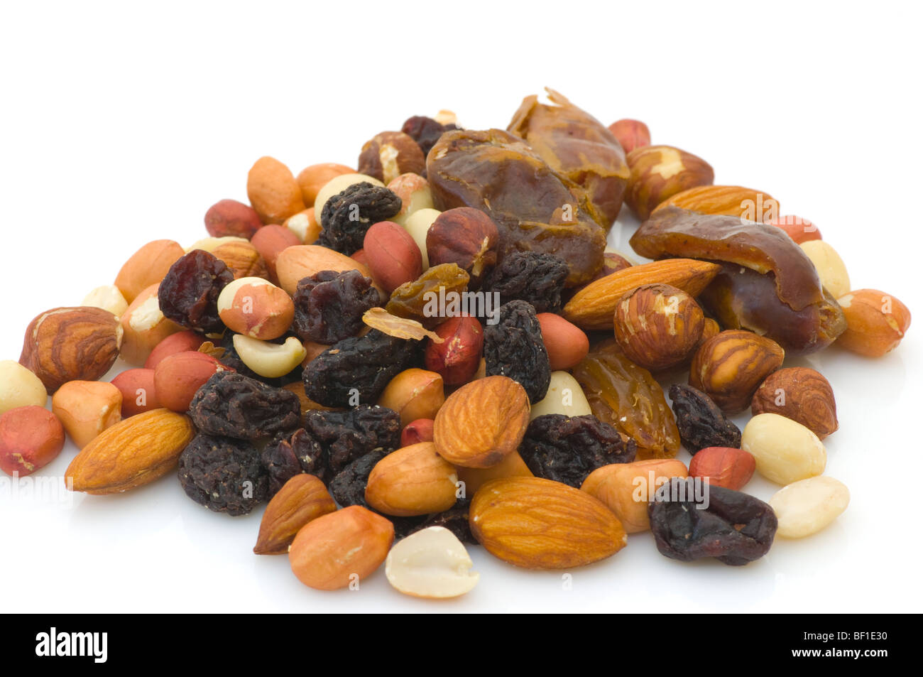 Pile Of Mixed Nuts and Dried Fruit Against A White Background Stock Photo