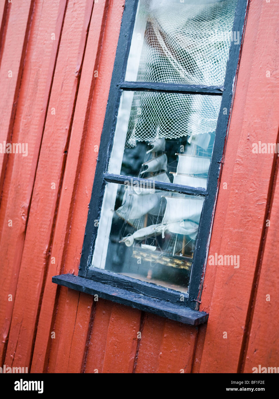 Window on a boathouse, Sweden. - Stock Image