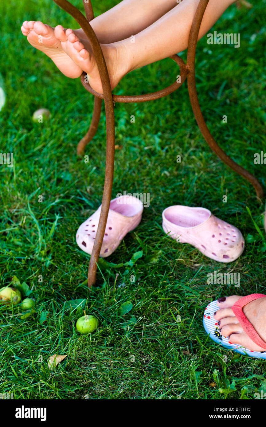 Feet and grass, Sweden. - Stock Image