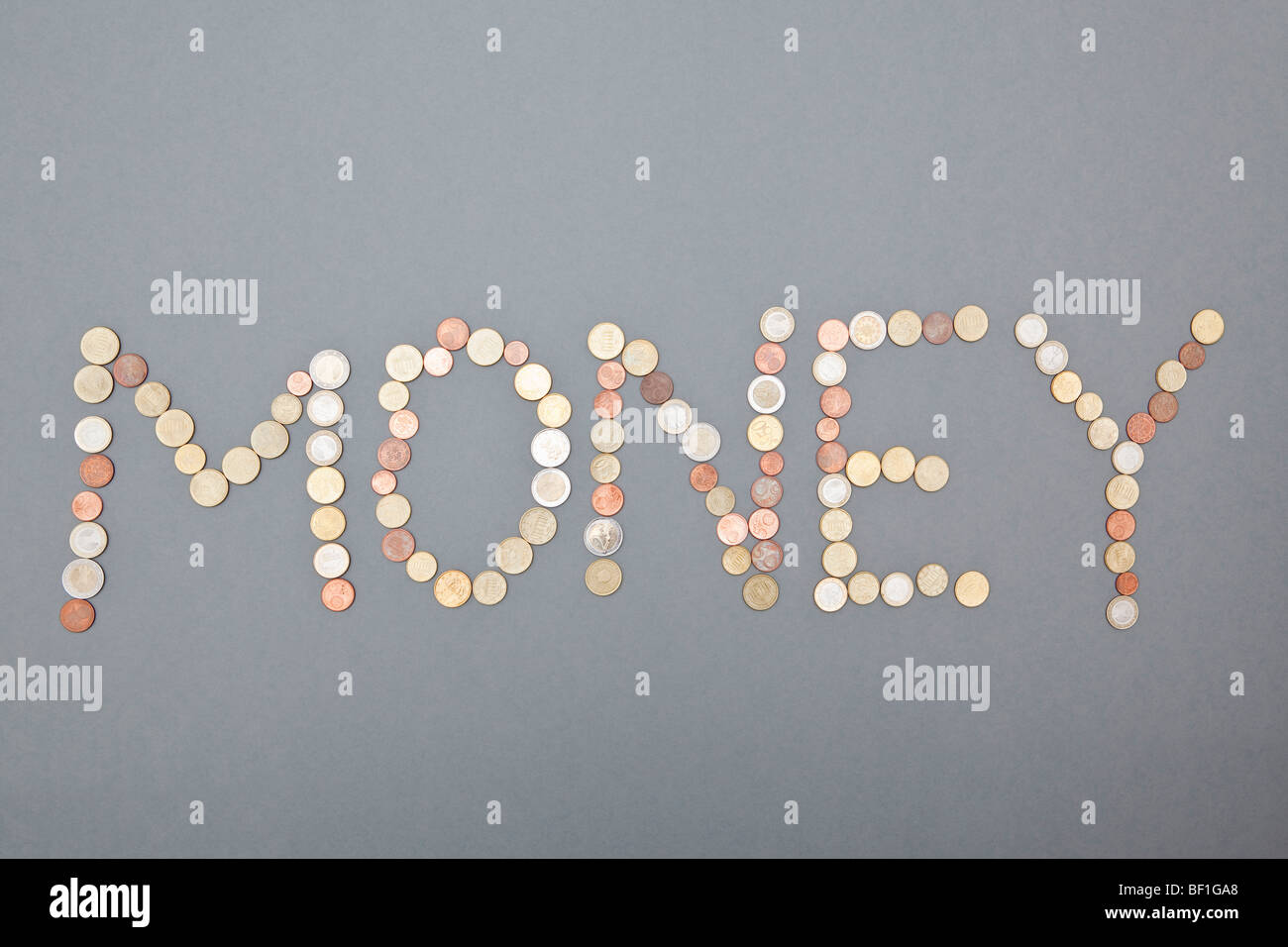 Coins spelling out MONEY - Stock Image