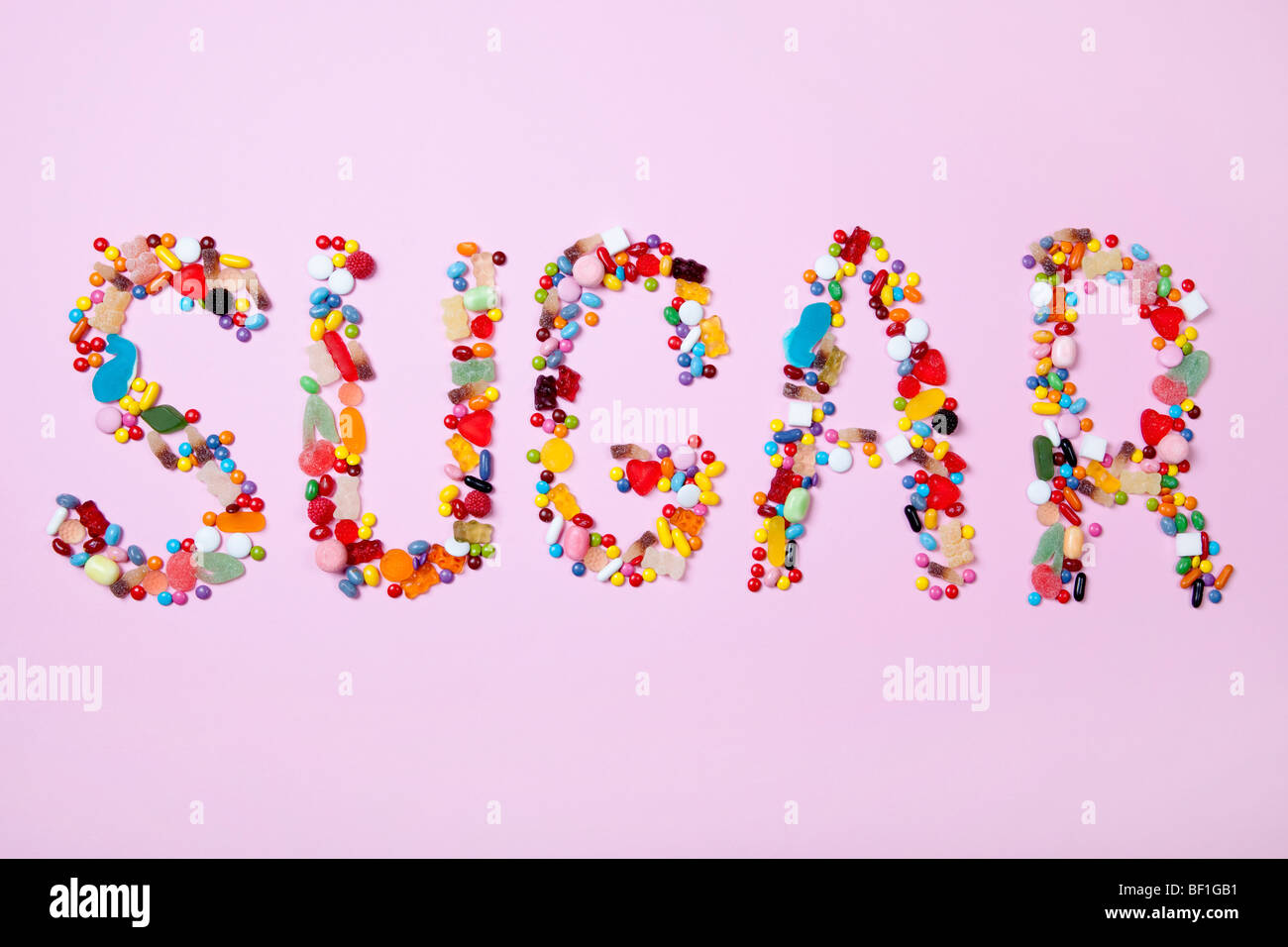 Candies spelling out SUGAR - Stock Image