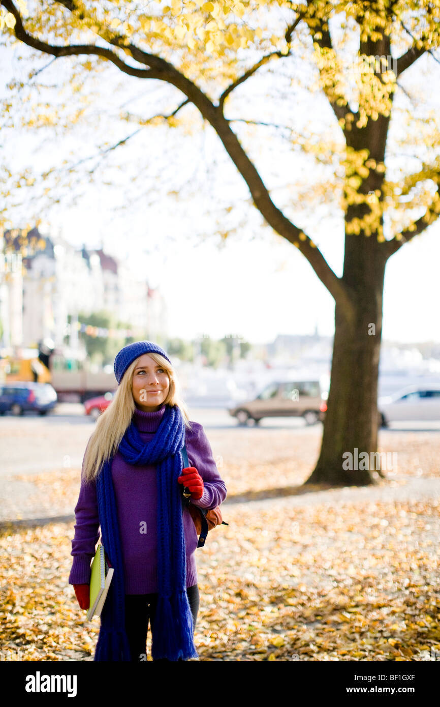 Young female student taking a walk in autumn, Stockholm, Sweden. Stock Photo