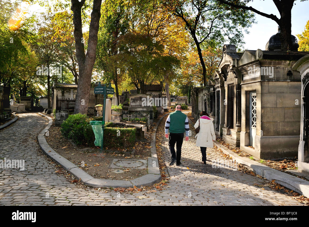 Paris, France - 'Pere Lachaise' Cemetery, Couple Walking on 'Cobbled Stone' Street - Stock Image