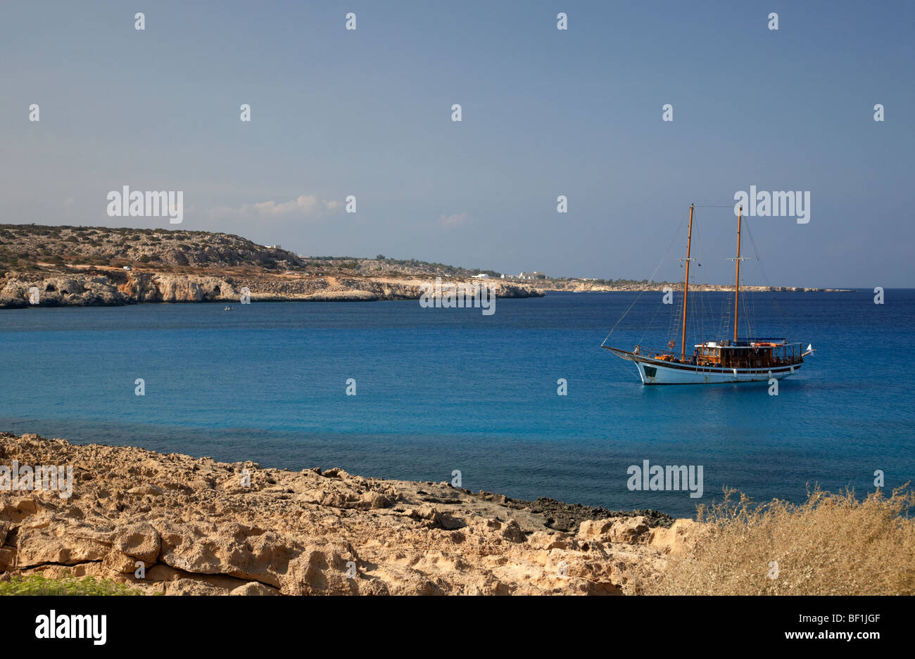 sailing boat moored in a quiet bay near cape gkreko greco republic of cyprus - Stock Image