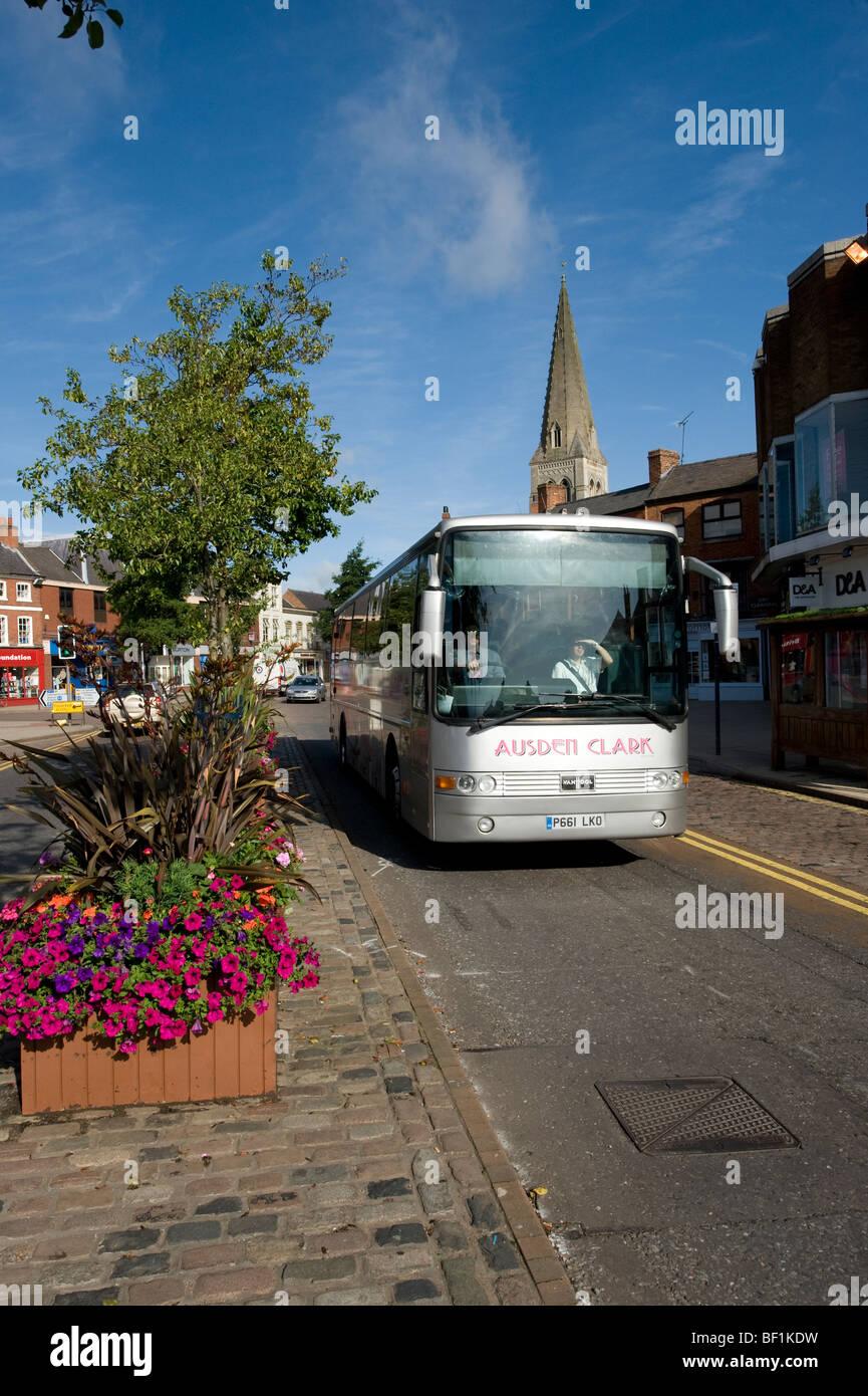 Ausden Clark coach on a tour passing through the market town of Market Harborough, Leicestershire - Stock Image