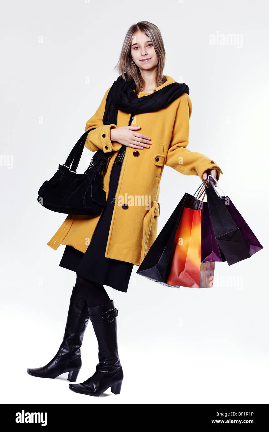 Young woman with paper bags - Stock Image