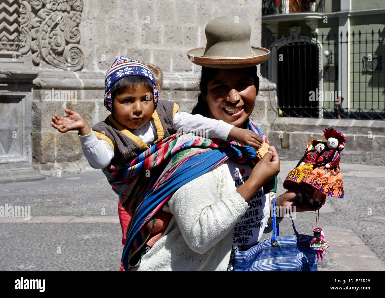 Lady Street Vendor and Baby in Arequipa, Peru - Stock Image