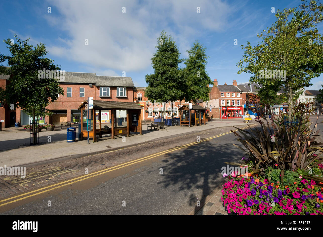 Bus stops in the centre of the pretty market town of Market Harborough, Leicestershire - Stock Image