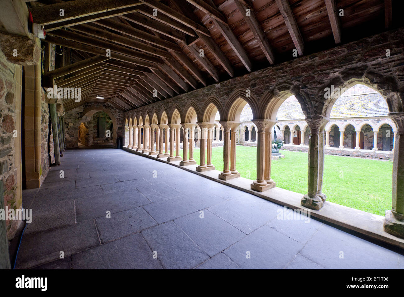 The cloisters and stone carvings of Iona Abbey on the Isle of Iona, Scotland - Stock Image