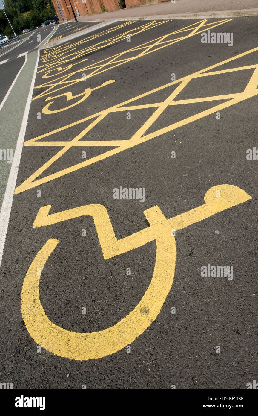 Car parking spaces reserved for disabled drivers in a car park in England. - Stock Image