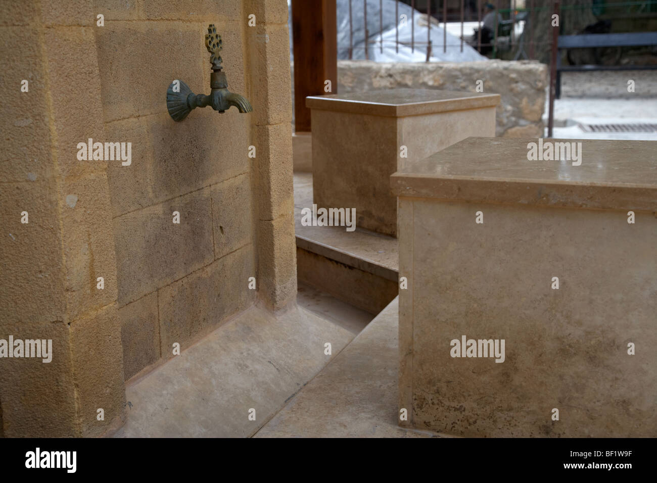 tap and seat at the ablution fountains outside the lala mustafa pasha mosque in famagusta - Stock Image