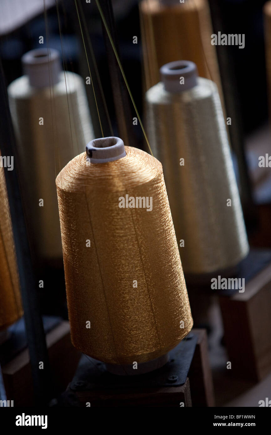 Spindles bobbins of silk threads. - Stock Image
