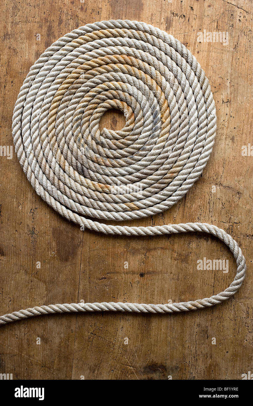 Rope coil on an antique chest - Stock Image