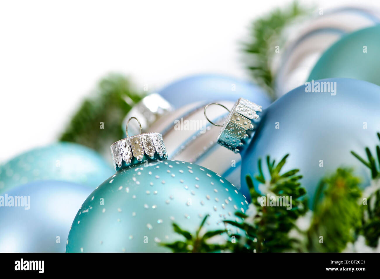 Many Christmas decorations laying in pine branches - Stock Image