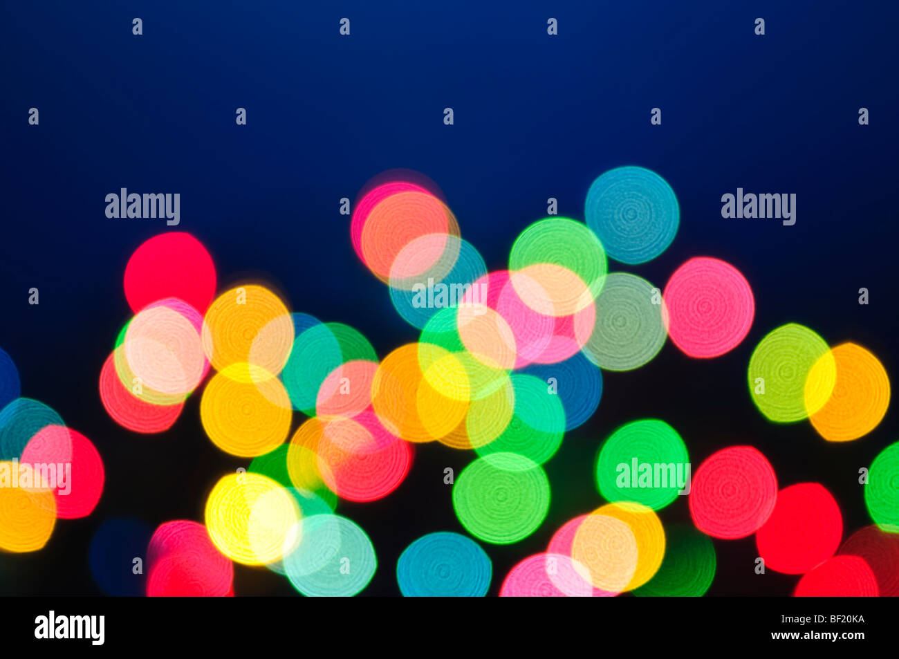 Out of focus multicolored Christmas light background - Stock Image