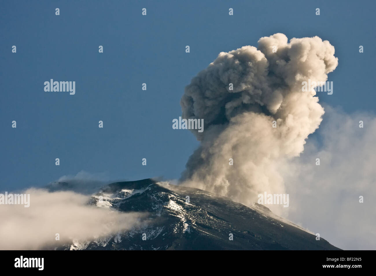Tortugeuro volcano blowing off ash and smoke, a minor eruption. - Stock Image