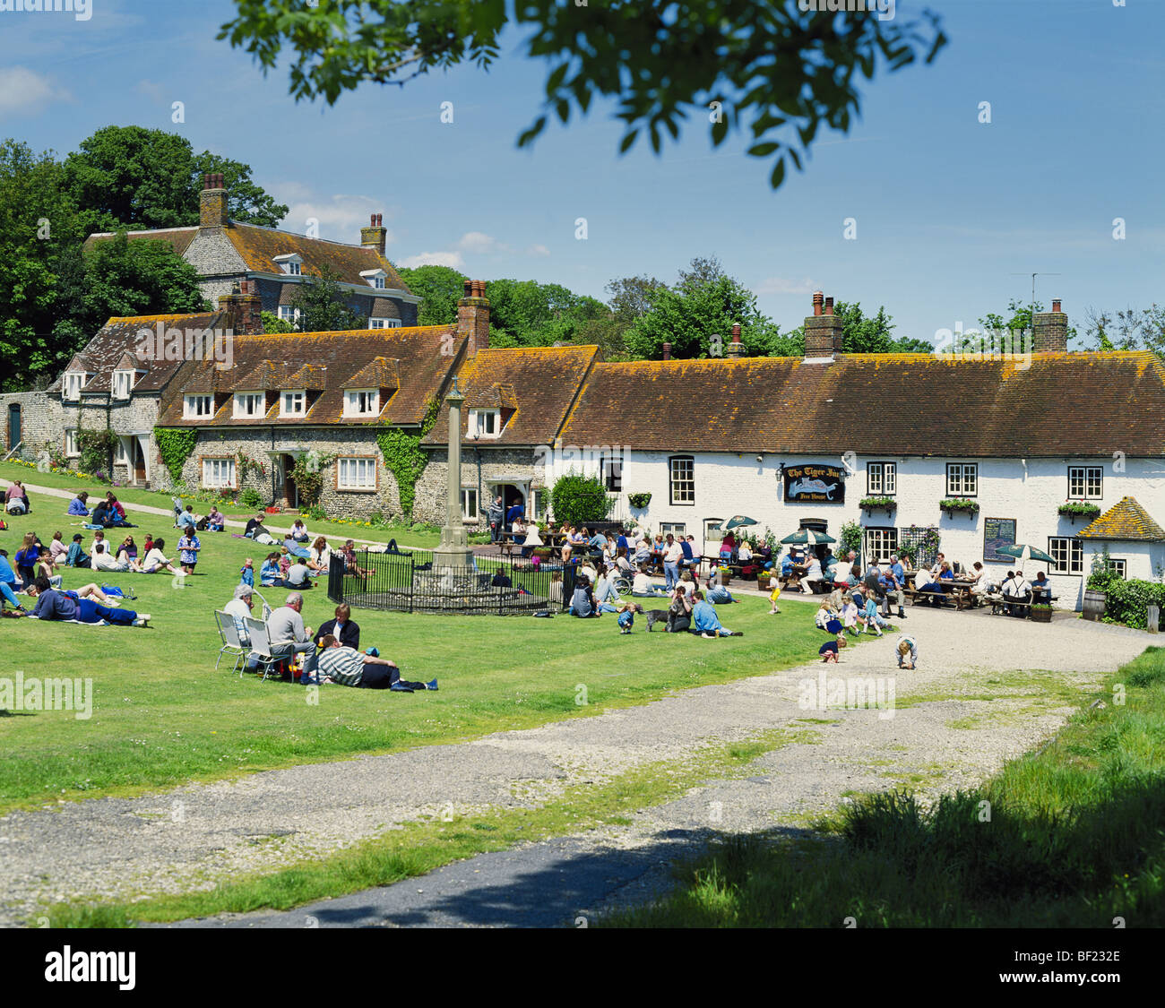 East Dean Village Green and the Tiger Inn, East Sussex, England, UK, GB - Stock Image