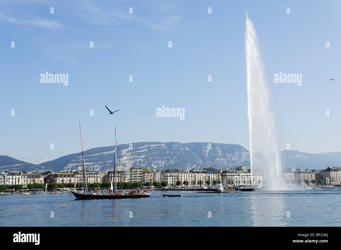 Excursion boat and Jet d'Eau (one of the largest fountains in the world), Lake Geneva, Geneva, Canton of Geneva, Stock Photo