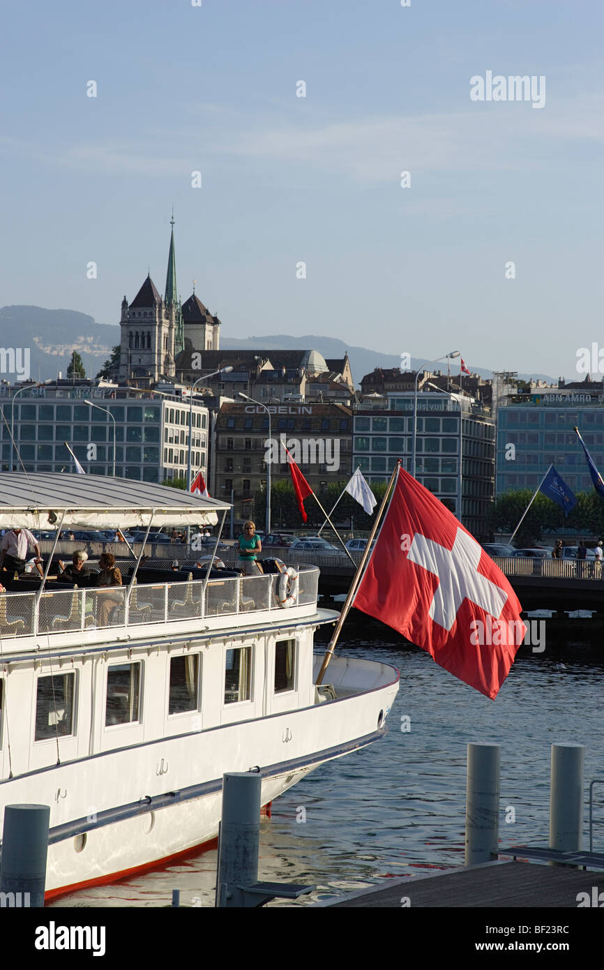 St. Pierre Cathedral and excursion boat with Swiss flag, Geneva, Canton of Geneva, Switzerland - Stock Image