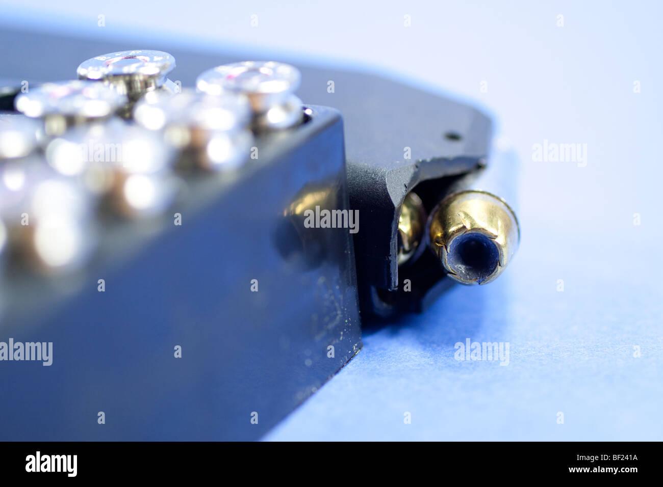 Ammunition and Glock .40 caliber high-capacity magazine. - Stock Image